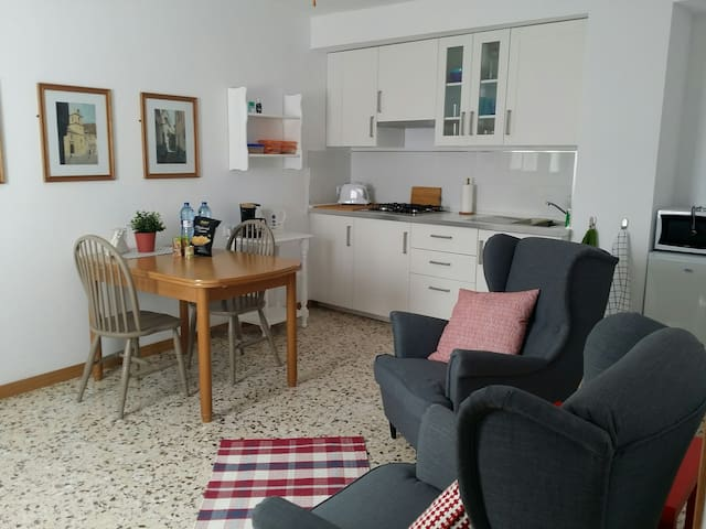 Living space.  With complete fitted kitchen including fridge, microwave, coffee machine, toaster and kettle. Dining space, comfortable seating and television.