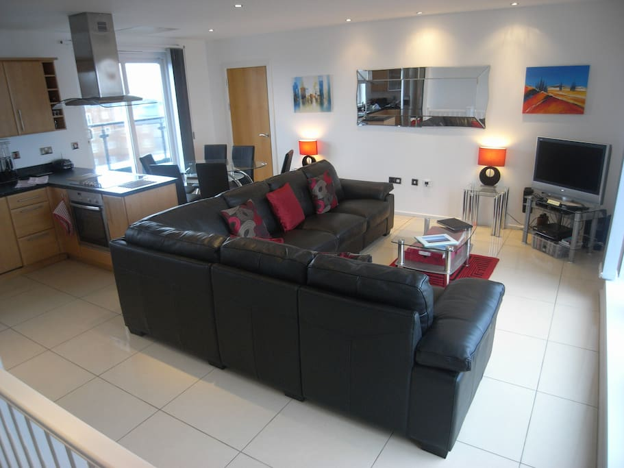 Large open plan living area with views of the beach