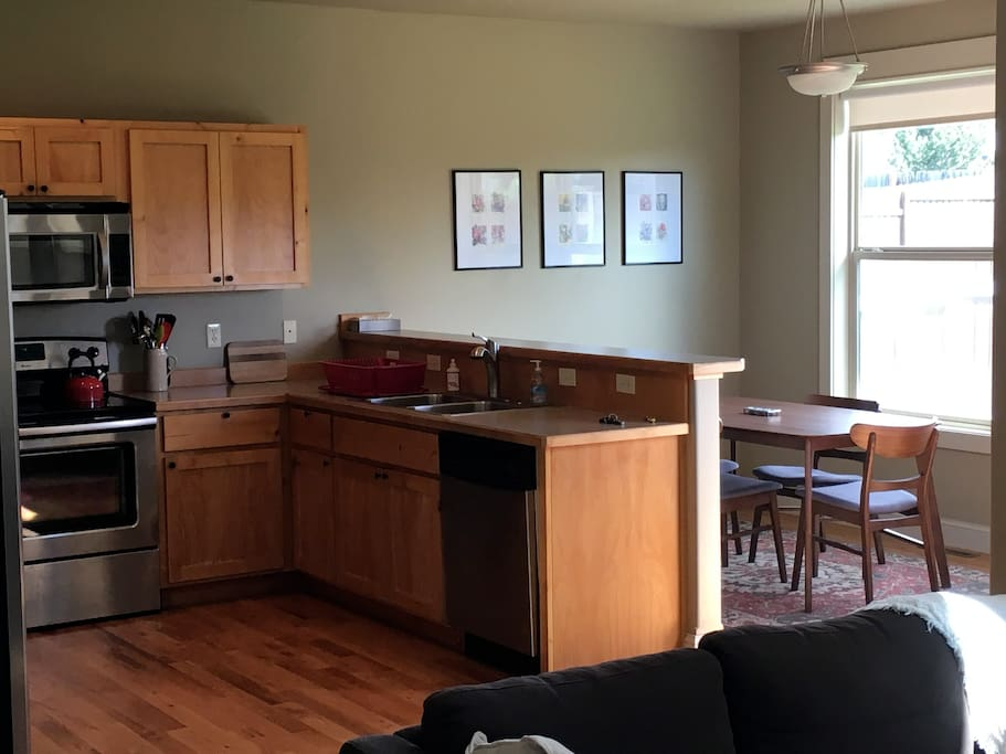 Open concept kitchen/dining room with lots of light.