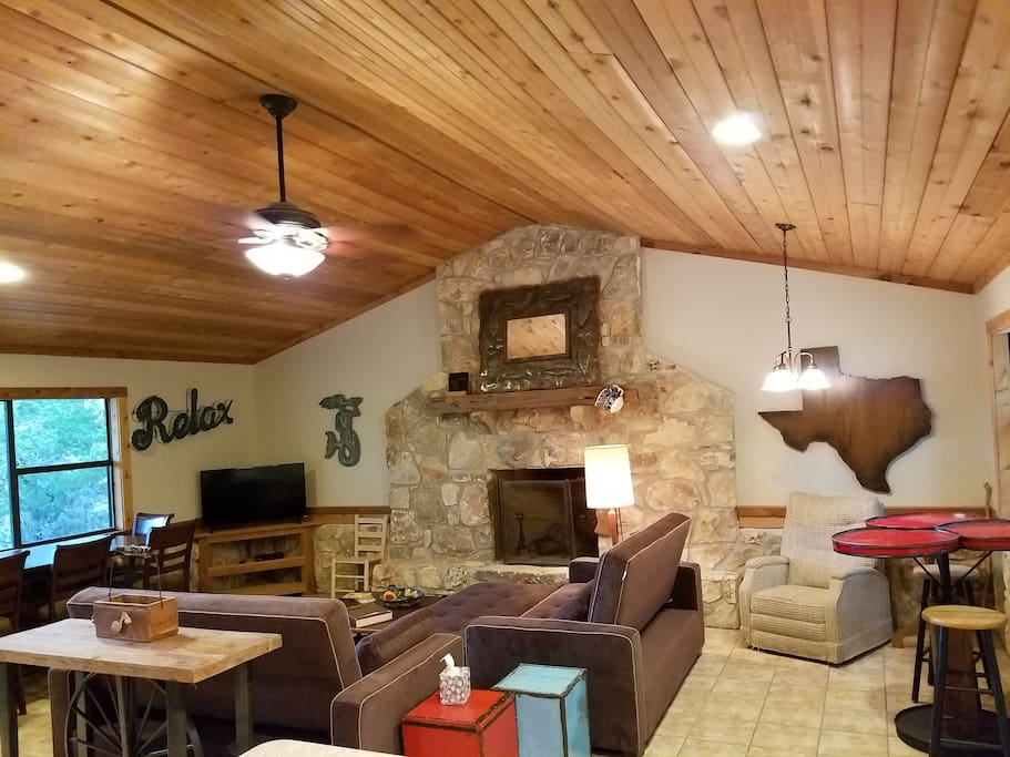 beautifully appointed living room with Serta queen sleeper sofas, and a bar table and more