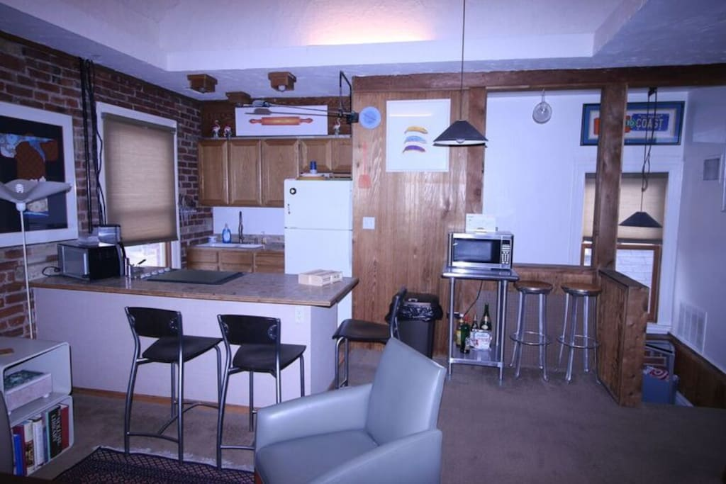 Full kitchen with counter stool seating