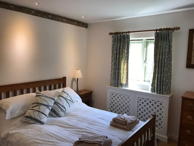 Double Bedroom facing East with views into the forest