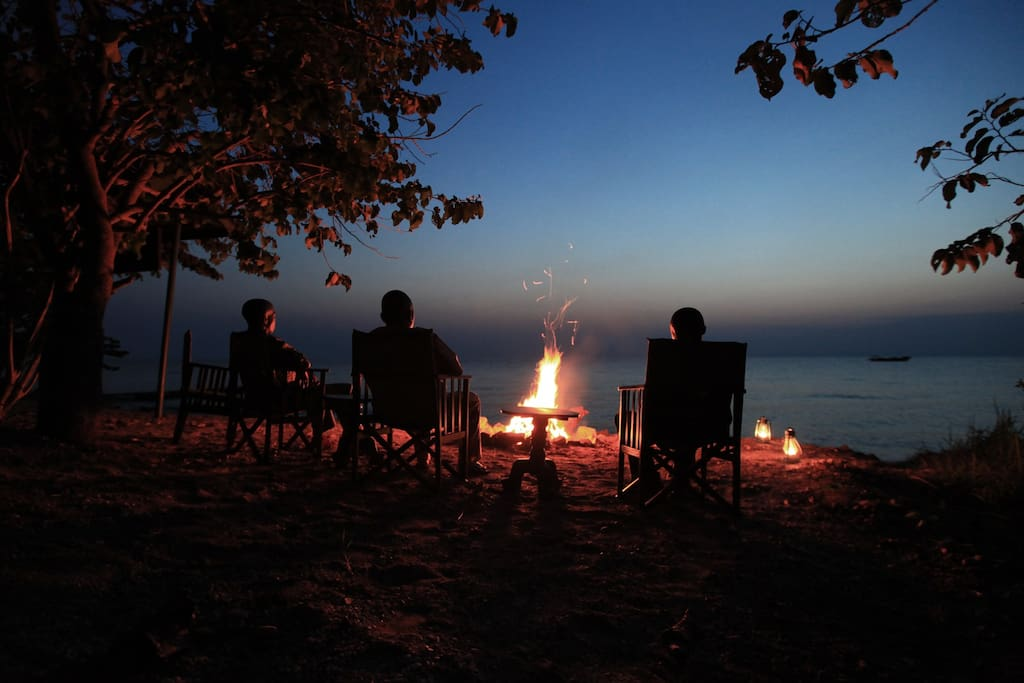 Unwind at our campfire as you watch the sun set over Lake Tanganyika