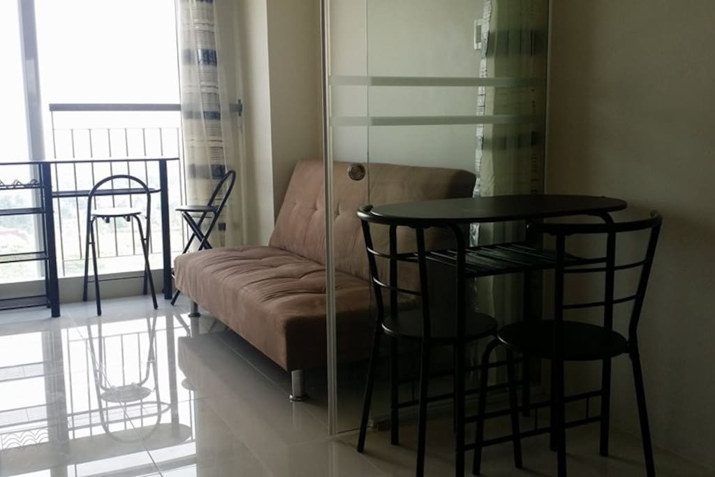 Dining with a view! 2 seater breakfast table + Sofa Bed in kitchen/living room + 2 seater dining table in bedroom