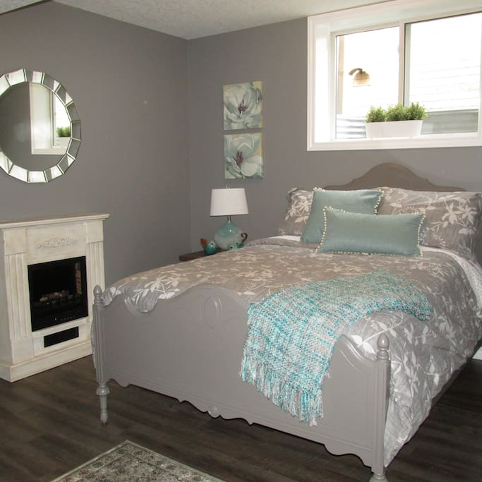The second bright lower level bedroom with fireplace - double bed