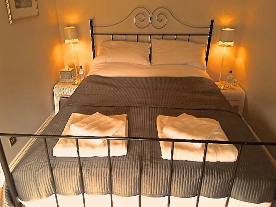 Room with wrought iron Kingsize Bed and ensuite