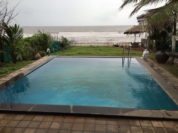 Entire Bungalow with a beach facing swimming pool