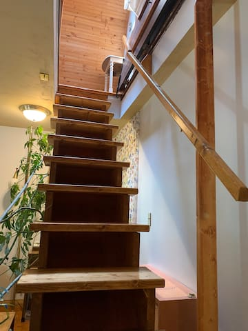 """Must be able to climb stairs to main studio bedroom.  This may also be a hazard for young children. A """"hatch"""" door in the ceiling/floor helps regulate air temperature."""