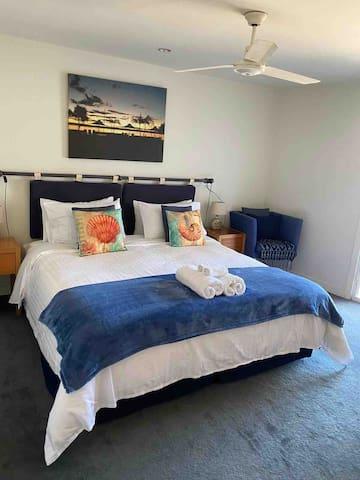 Main bedroom. Views to marina and beach.