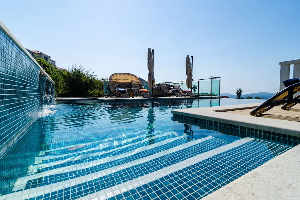 The villa's infinity pool is the most impressive spot, but it would not be as stunning if there were no large gardens, open view of the sea and the village and so much open space, that offers privacy, relaxation and peace for the guests.