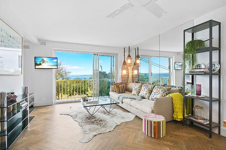 Stunning open plan living room with 180 degree views of the water