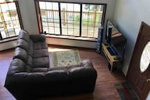 """The main living area. 70"""" Tv with home theatre, surround sound and a good Blu Ray movie selection. If it rains this is the place to be."""