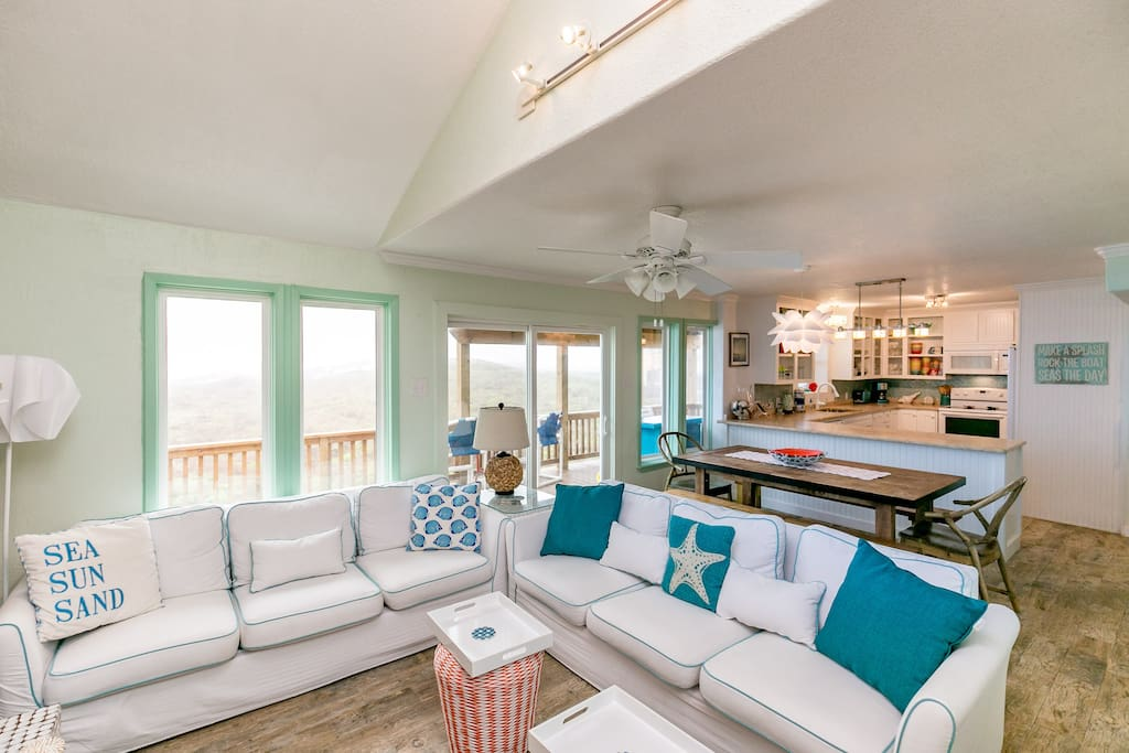 Beachy sectional and sliding doors to an ocean-view deck!