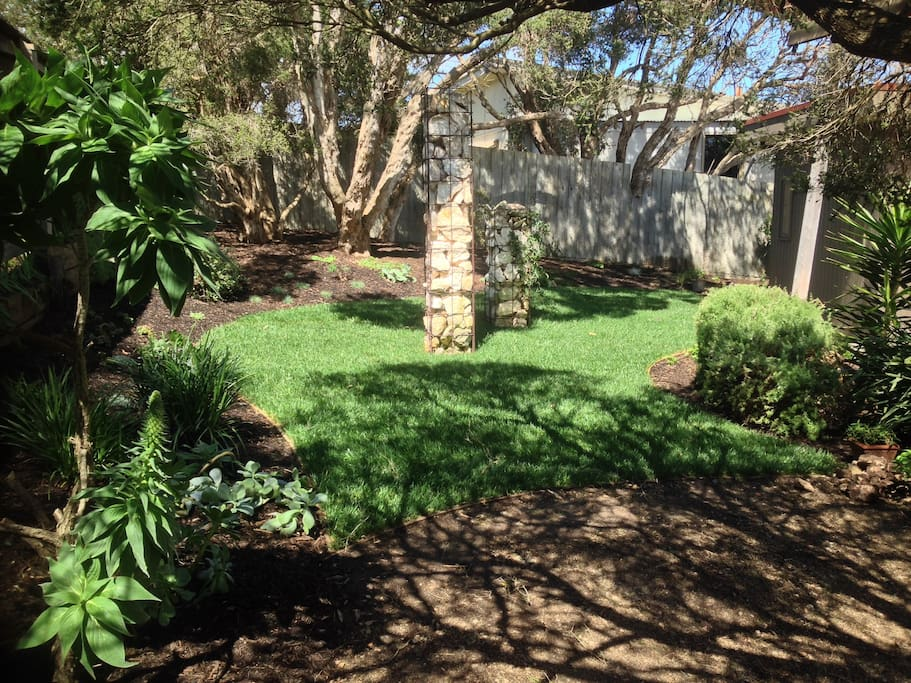 Native garden featuring 300 year old moonah trees & herb garden