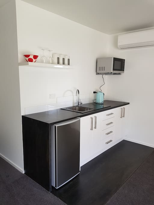 Kitchenette with fridge microwave, tea & coffee