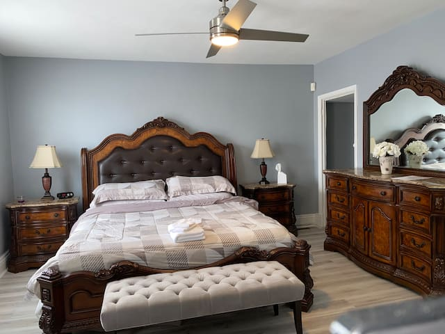 """Spread your belongings & sleep comfortably in the large master bedroom furnished with king size bed and 55"""" smart tv"""