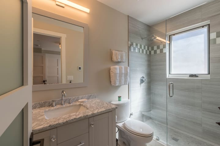 The 3rd bathroom offers a walk-in shower and heated floors.