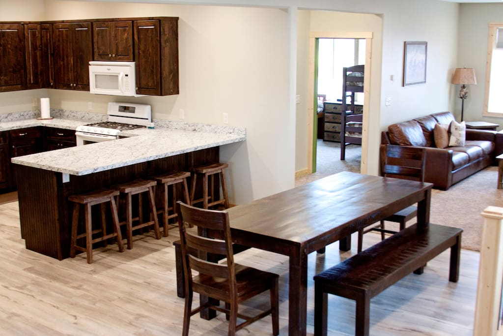 Kitchen, table, living space.