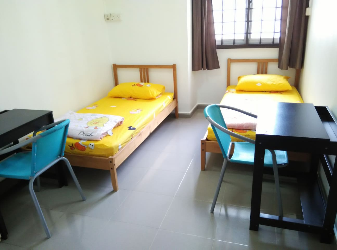 2 solid single beds each with a comfortable 6-inch spring mattress, a clean mattress protector, a clean bed sheet, a clean warm blanket and a clean comfortable pillow. Plus 2 desks, 2 chairs, a full-length mirror and a big wardrobe.