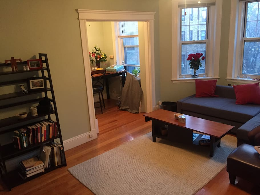 Living room with open area to kitchen