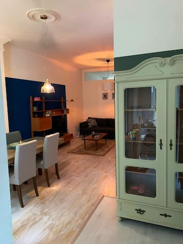 Living room with open kitchen and antique Dutch vitrine
