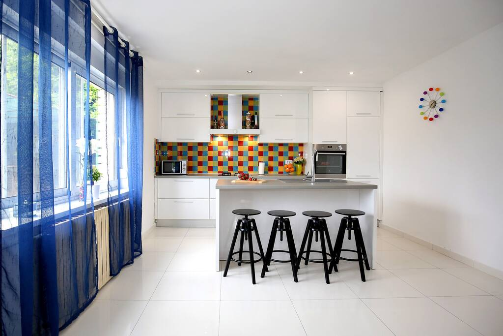 As you enter the apartment first thing you see is a big bright kitchen with colorful backsplash tiles to brighten up your day.