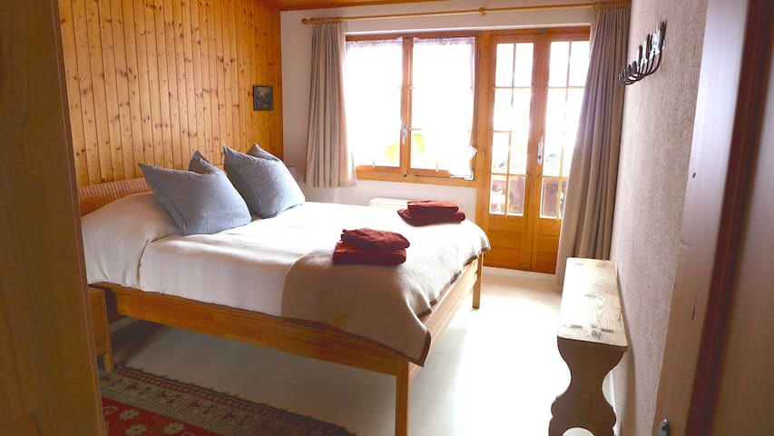 The main bedroom with access to the garden and a terrace.