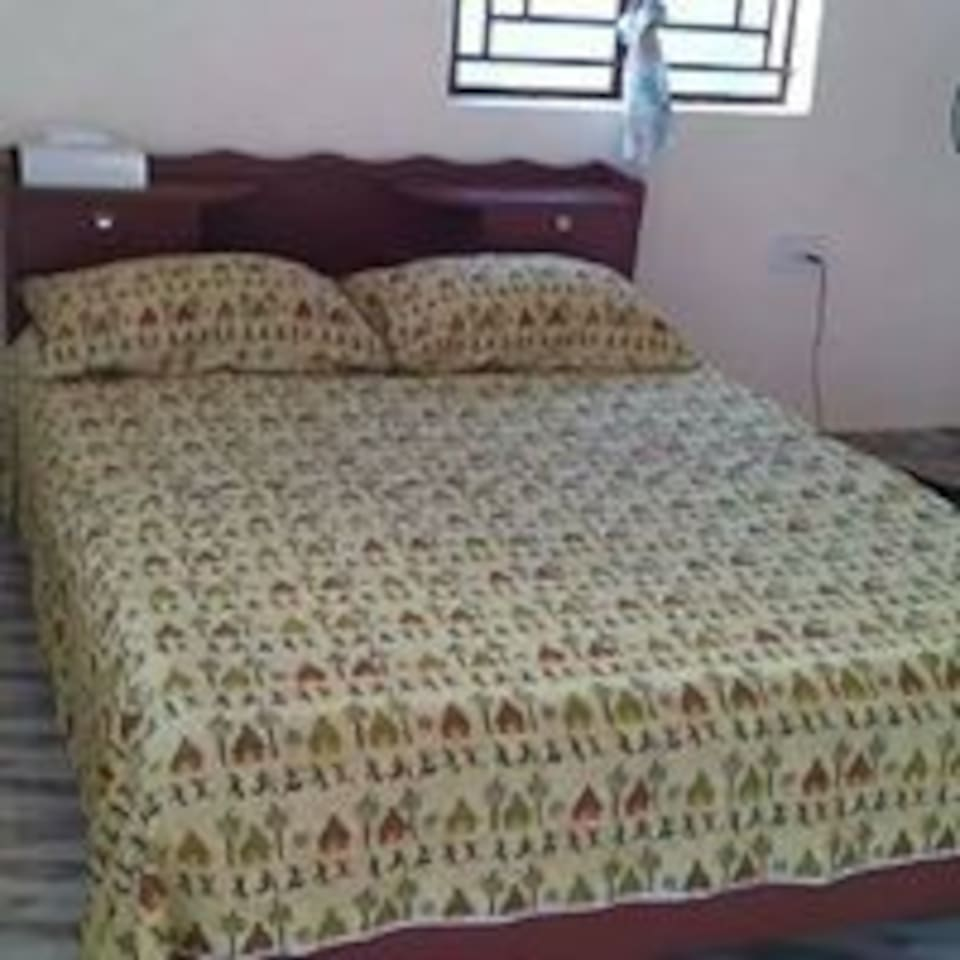 Clean African- themed rooms with your private fan.