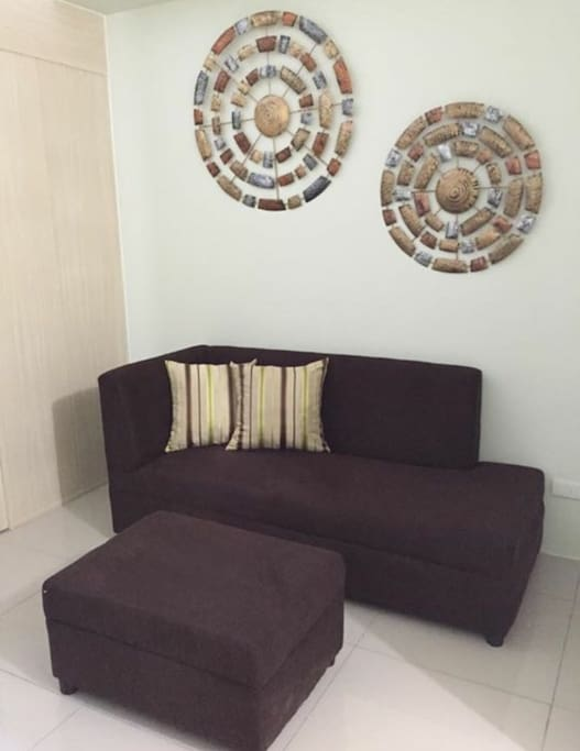 3 seater sofa with 1 foot rest