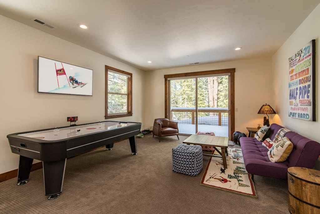 A game room offers a futon and air hockey table