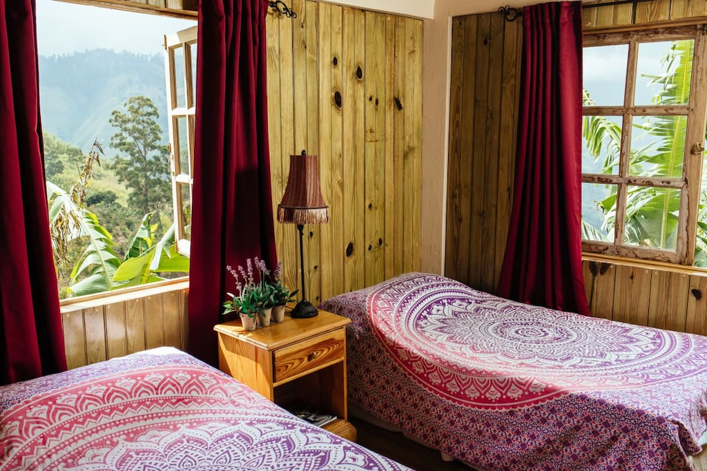 Butterfly Cottage interior, option for King bed or two twin beds. Photo credit Darlington Jones Imagery.