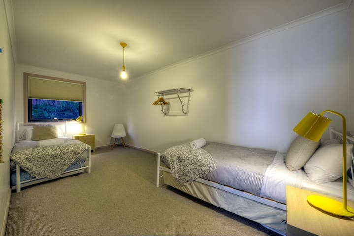 The second bedroom is very spacious with 2 single beds.