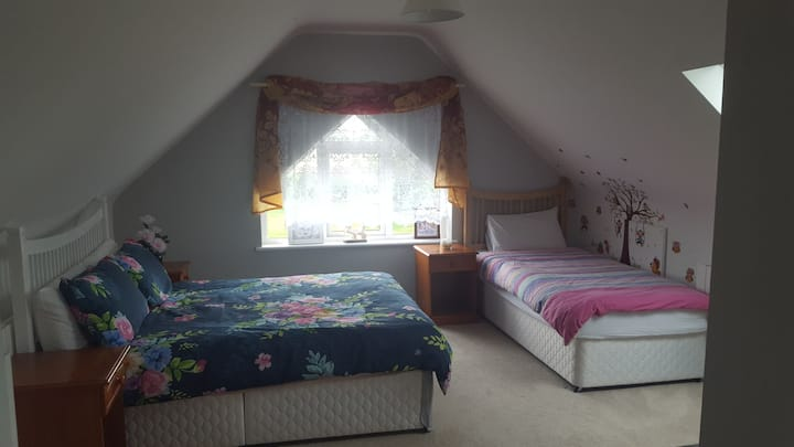 Private room with double bed and single bed