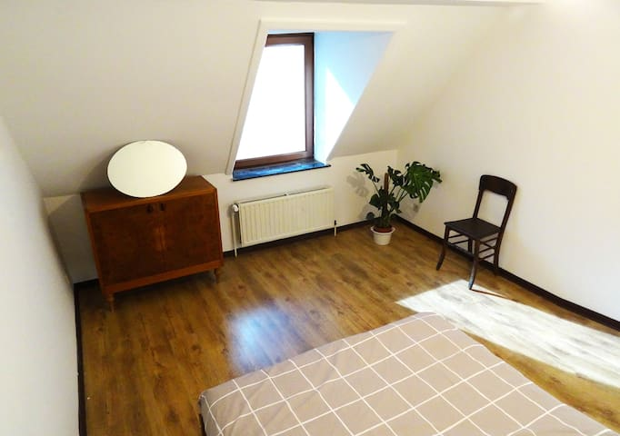 Bright room in penthouse apartment in Saint Gilles