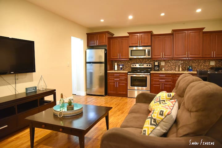 Kitchen and sofa with Tv