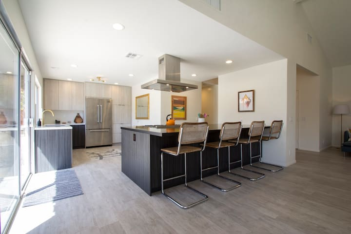 Open-concept kitchen with 12 foot island and 4 counter stools