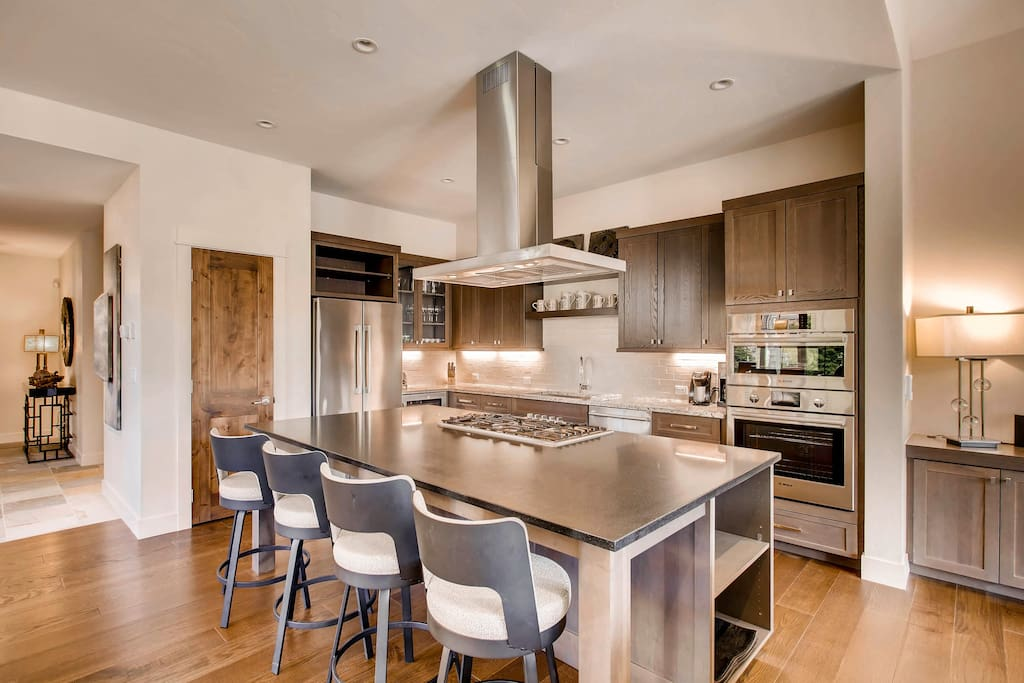 which opens to the living and dining area and also offers additional seating for dining