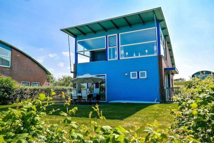 Seeblick Hafenhaus mit Sauna auf das Lauwersmeer