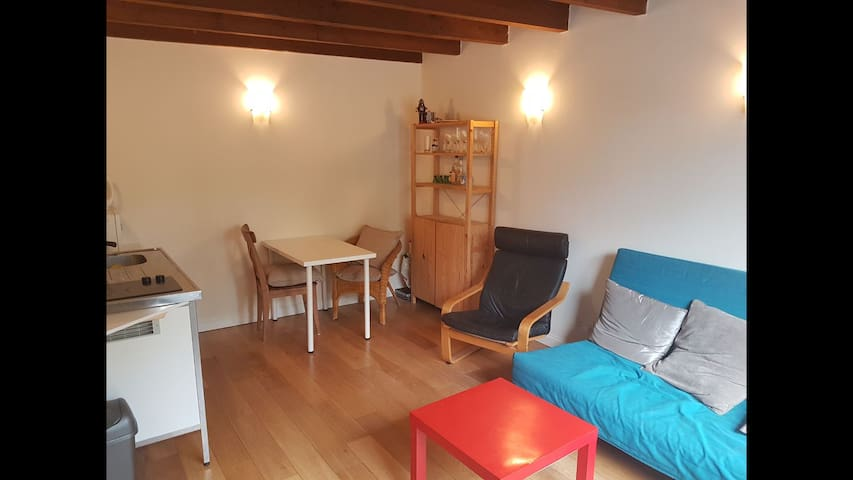Storage units and additional chairs, beautiful original wooden beamed ceiling.