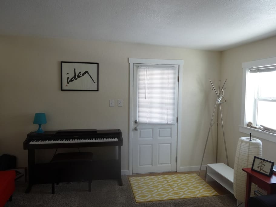 Sunny living room with electric piano