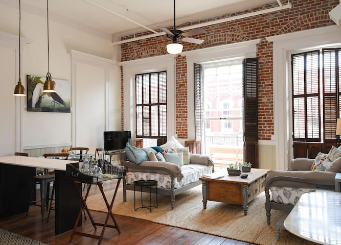 Downtown Loft with Private Balcony on The Strand at Historic Hendley Market! | Audubon Room with Balcony