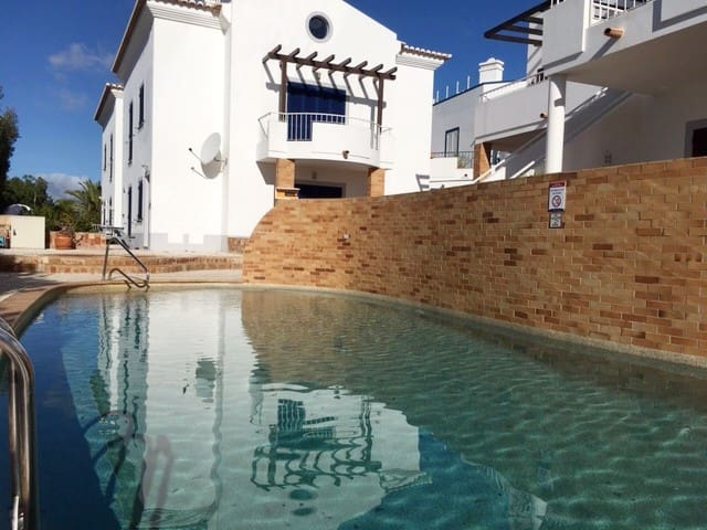 Spacious apartment with terrace and heated pool.