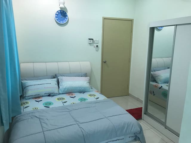 Bedroom 2 view-1; accommodated with a queen bed, air-conditioned & shared bathroom.