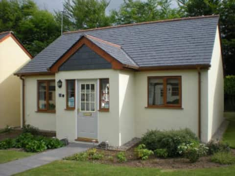 Front of Chynance with a handy porch and small front garden to welcome you.