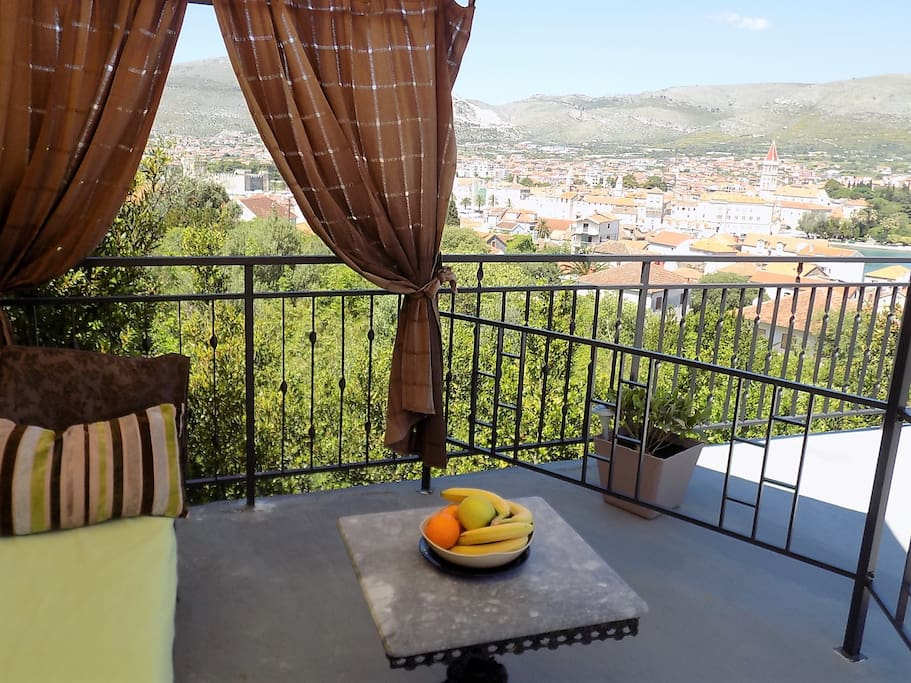 Terrace with views of the entire city, the sea with a gazebo, sofa, chairs and lounges