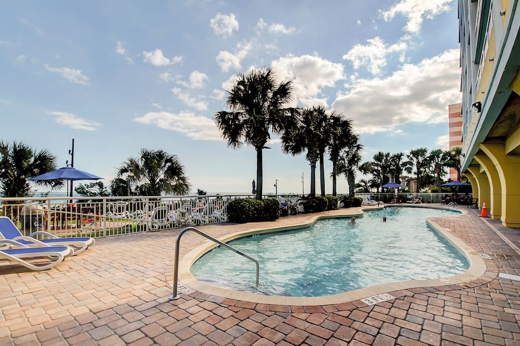 Overlooking the beach is the 60' outdoor pool with plenty of lounge chairs.