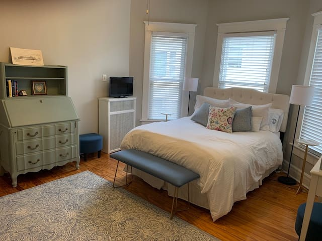 Master Bedroom: Bay windows are the perfect backdrop to your queen size, comfy bed.