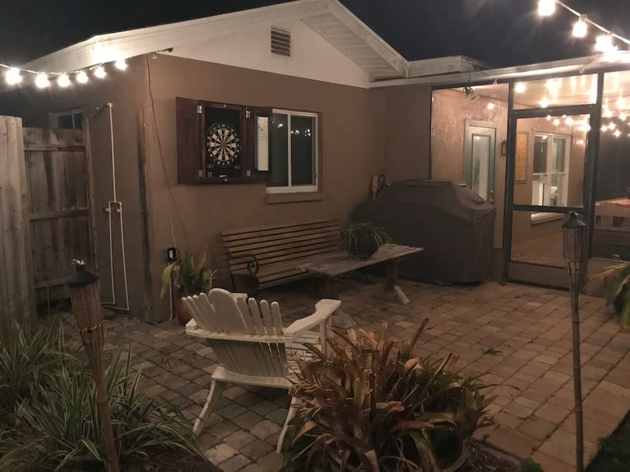 Back porch has grill, darts and outdoor shower