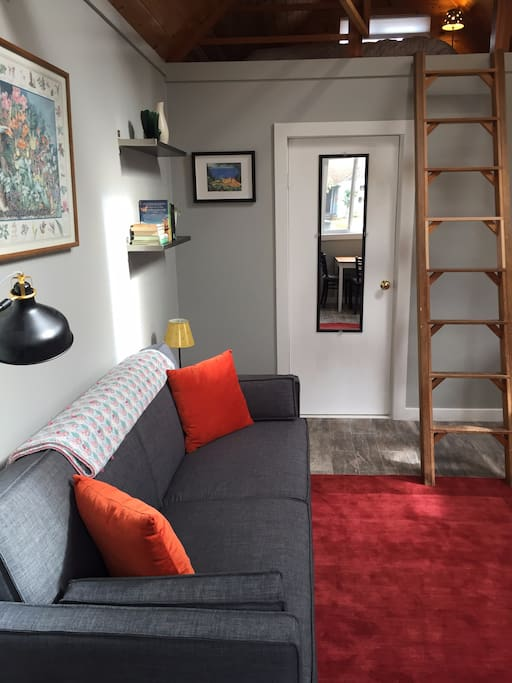 pull out sofa and ladder leading to sleeping loft