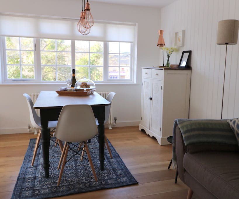 Open plan living, dining area overlooking the stream and the village centre